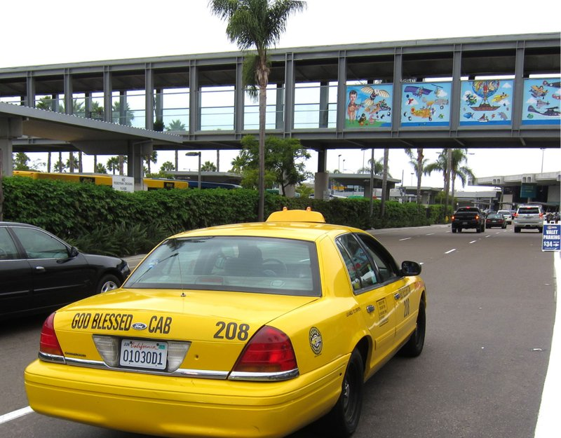 A yellow cab drives past San Diego International Airport on Sept. 16, 2011.