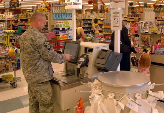 Service member shopping at a commissary.