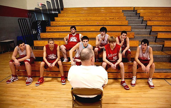 Assistant coach Rudie Crain with the Medora Hornets varsity basketball team.