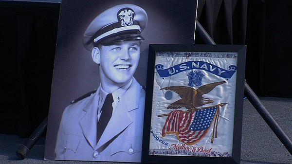 A photo of U.S. Navy veteran John Francis Pintar on display at the USS Midway...