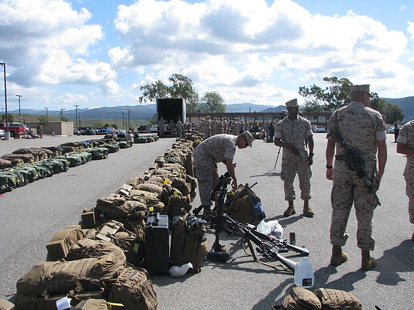 Marines line up their gear before deploying from Camp Pendleton to Australia,...