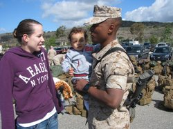 Cpl. Jason Singleton with his wife and son, before deploying from Camp Pendleton to Australia, April 1, 2014.