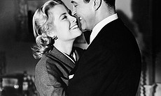 Welsh actor Ray Milland hugs Grace Kelly in a s...