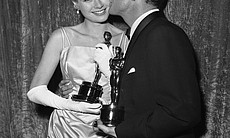 Grace Kelly holding her Oscar after she was hon...