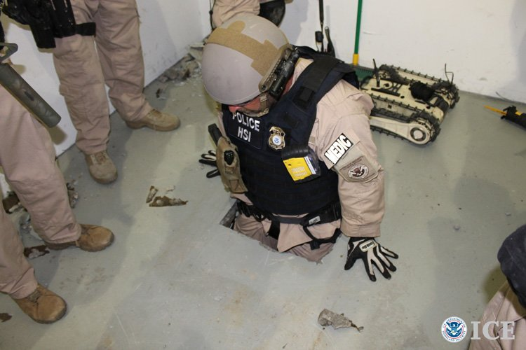 A federal agent climbs into a drug tunnel discovered in an Otay Mesa warehous...