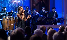 Ariana Grande performs. President Barack Obama and First Lady Michelle Obama ...