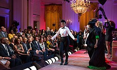 "Janelle Monáe performs on stage with Tessanne Chin, Melissa Etheridge, Ariana Grande, Patti LaBelle, and Jill Scott. President Barack Obama and First Lady Michelle Obama host ""Women Of Soul: In Performance At The White House"" in the East Room of the White House, March 6, 2014."