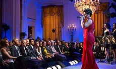 Tessanne Chin performs. President Barack Obama and First Lady Michelle Obama ...