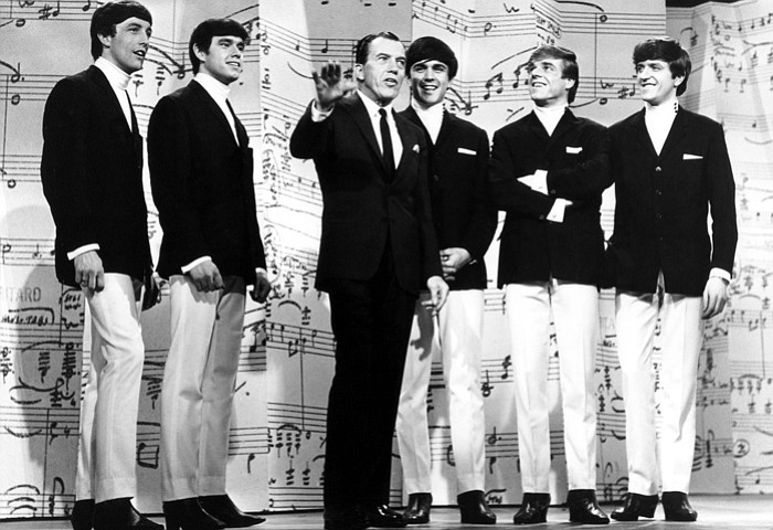 The Dave Clark Five on stage with Ed Sullivan (center).