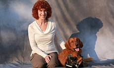 Kathy Wyer and Roofus the dog, portrait on gray...