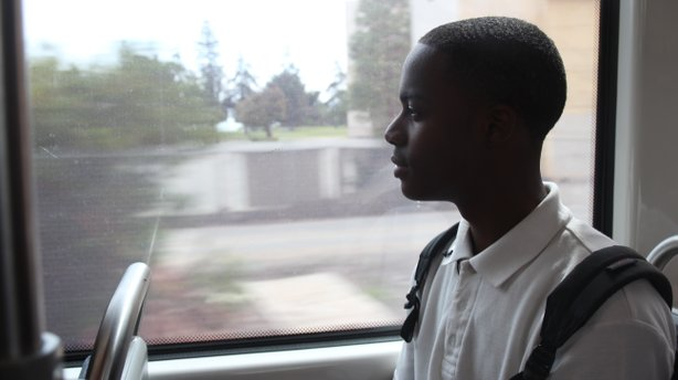 Thomas Poston, 17, rides the trolley from San Diego High School to his home i...