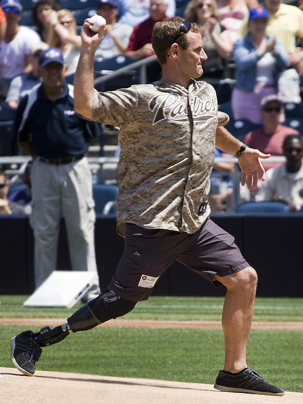 Ceremonial First Pitch is thrown at Petco Park by a milit...