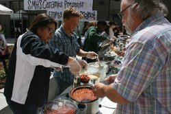 San Marcos High School senior Xiamora Martinez serves up a bowl of chili to M...
