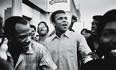 Muhammad Ali walks through the streets of New York City with members of the B...