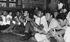 Ali prays at Hussein Mosque in Cairo, June 1964, after announcing he is part of the Nation of Islam.