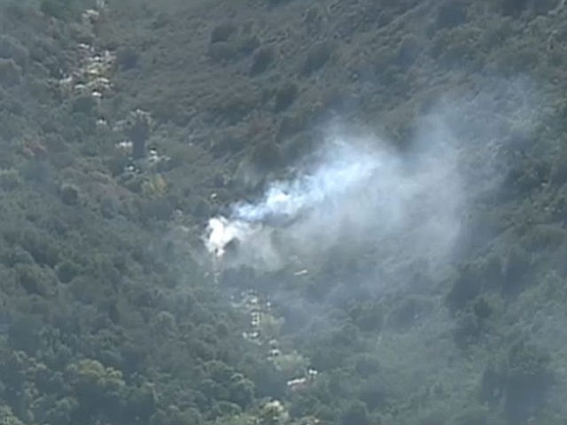 A brush fire, which burned about a half-acre near Snook Street and Collett Wa...