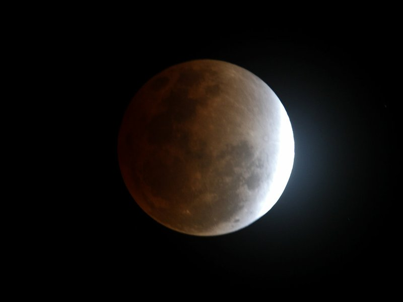 The moon seen from Manila, Philippines, during a total lunar eclipse in Decem...