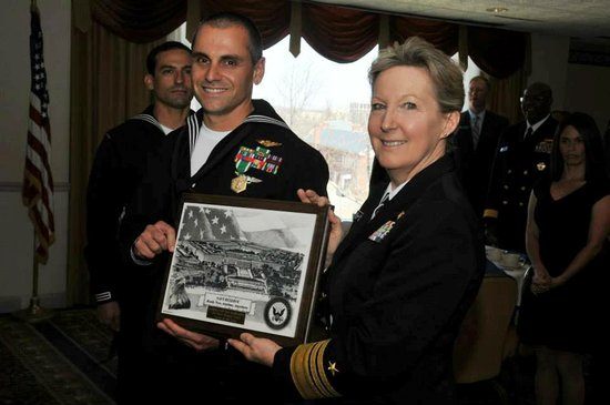 Vice Adm. Robin Braun congratulates Naval Aircrewman (Helicopter) 1st Class Paul Marticorena for being selected as the Navy Reserve Sailor of the Year during a ceremony held April 10.
