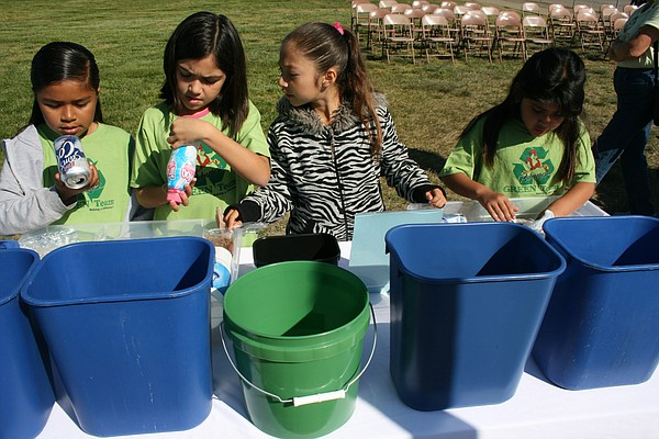 Palmquist Elementary green team members Natally Ramirez, ...