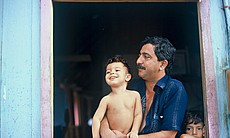 "Chico Mendes and his son Sandino. AMERICAN MASTERS ""A Fierce Green Fire"" charts the rise of global resource crises in the 1980s with the struggle to save the Amazon rainforest, led by Chico Mendes and his fellow Brazilian rubber tappers, as its centerpiece."