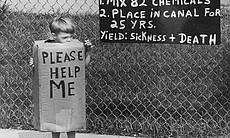 "A local boy in Niagara Falls, New York, protests toxic contamination of Love Canal, as seen in AMERICAN MASTERS ""A Fierce Green Fire."""