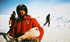 "Greenpeace co-founder Paul Watson takes a seal pup in his arms to protect from sealers (Belle Island, Canada), as seen in AMERICAN MASTERS ""A Fierce Green Fire."""