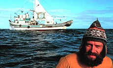 "Greenpeace activist Robert Hunter in front of Phyllis Cormack, North Pacific Ocean, during the first Greenpeace anti-whaling campaign, as seen in AMERICAN MASTERS ""A Fierce Green Fire."""