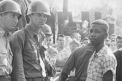 Fifteen-year-old Terrence Roberts (right) is denied entrance to Little Rock Central High School by the National Guard in 1957.