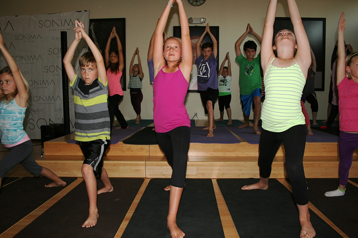 Encinitas students demonstrate yoga poses, April 2014.