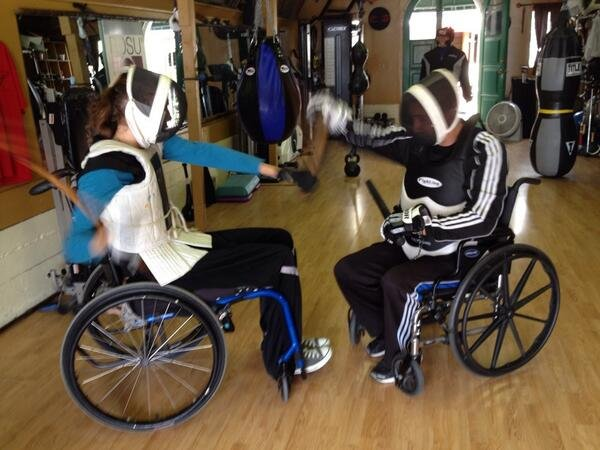 Therese Riedel (left) spars with trainer Greg Fraser duri...