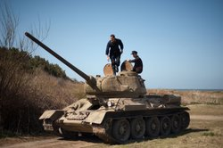Tiger Loader disembarks from tank.