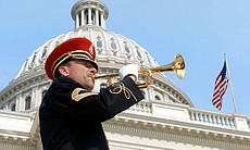 A bugler stands proudly before the U.S. Capitol...
