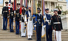 The Color Guard stands proudly before the U.S. Capitol.