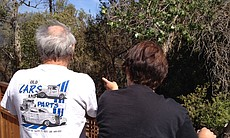 Robert and Lynn Dillon watch nervously as a wildfire burns near their home on Willowgrove Avenue in Santee.
