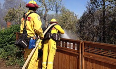 Fire crews battle a brush fire in Santee that broke out in the afternoon on April 29, 2014.