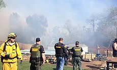 Authorities respond to a brush fire in Santee, April 30, 2014.