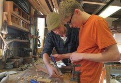 Boat builder Jeffrey Lane works with apprentice Graeme Potter at Lowell's Boat Shop.