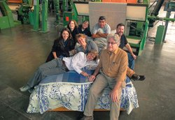 The Oriole Mill staff with their bedding products. At the Oriole Mill in Hendersonville, North Carolina, American textile manufacturing is thriving once again.