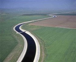 This undated file photo released by the California Department of Water Resources shows water making its way south through the Central Valley by way of the California Aqueduct.
