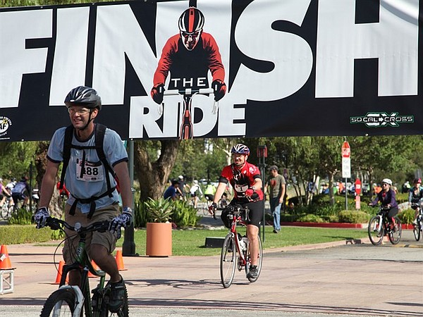 Damian Kevitt rolls through the finish line a year after ...