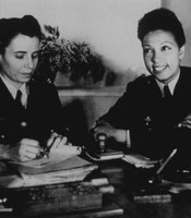 American born entertainer, dancer and singer Josephine Baker (1906 - 1975) (on right), as a volunteer in the Free French Women's Air Auxiliary, circa 1940. (Agency reference - 3309754)