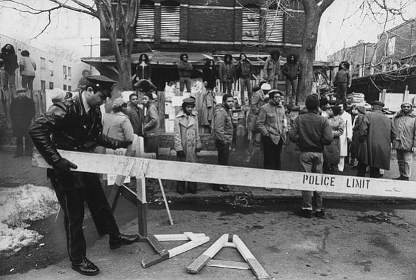 MOVE members and police during the 1978 confrontation outside MOVE headquarters.