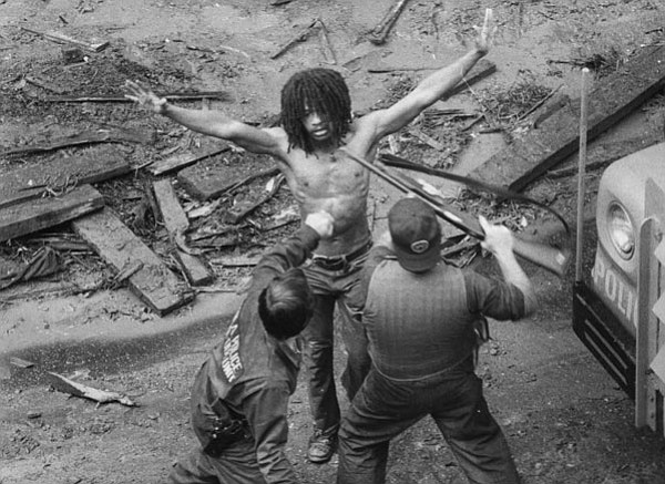 Delbert Africa is arrested by police after the 1978 gun b...