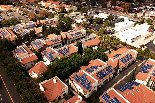 This undated photo shows solar panels on a San Diego affo...