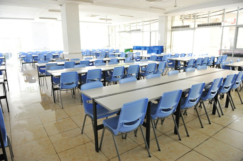 Bon Empty Cafeteria Tables Are Shown In This Undated Stock Photo.