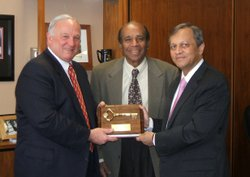 Dr. Madhavan, in 2007, with then San Diego Mayor, Jerry Sanders (Left) and Am...