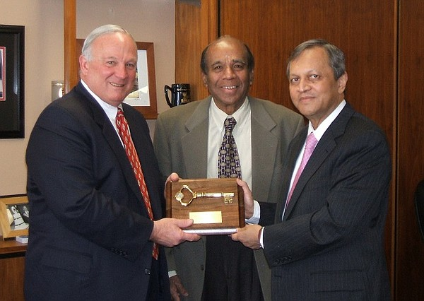 Dr. Madhavan, in 2007, with then San Diego Mayor, Jerry S...