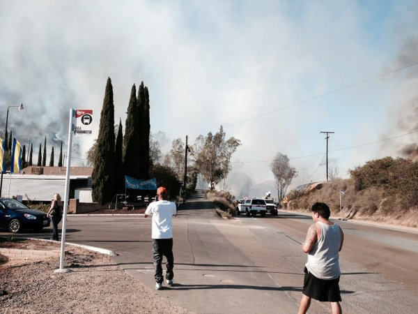 Smoke from a El Cajon trailer park is seen, May 14, 2014.
