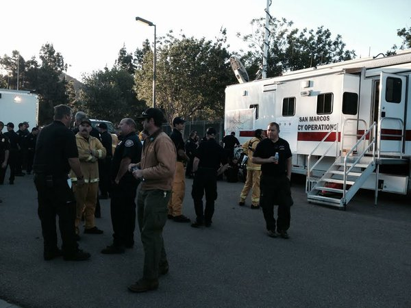 Fire officials at the Bernardo Fire command center at the...