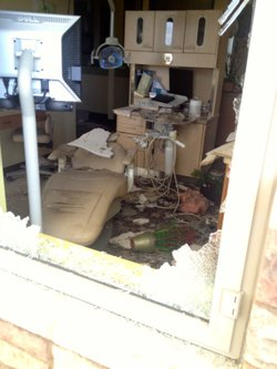 Flames leapt into Jeff Knutzen's dental practice shortly after the Poinsettia Fire broke out in a nearby canyon.
